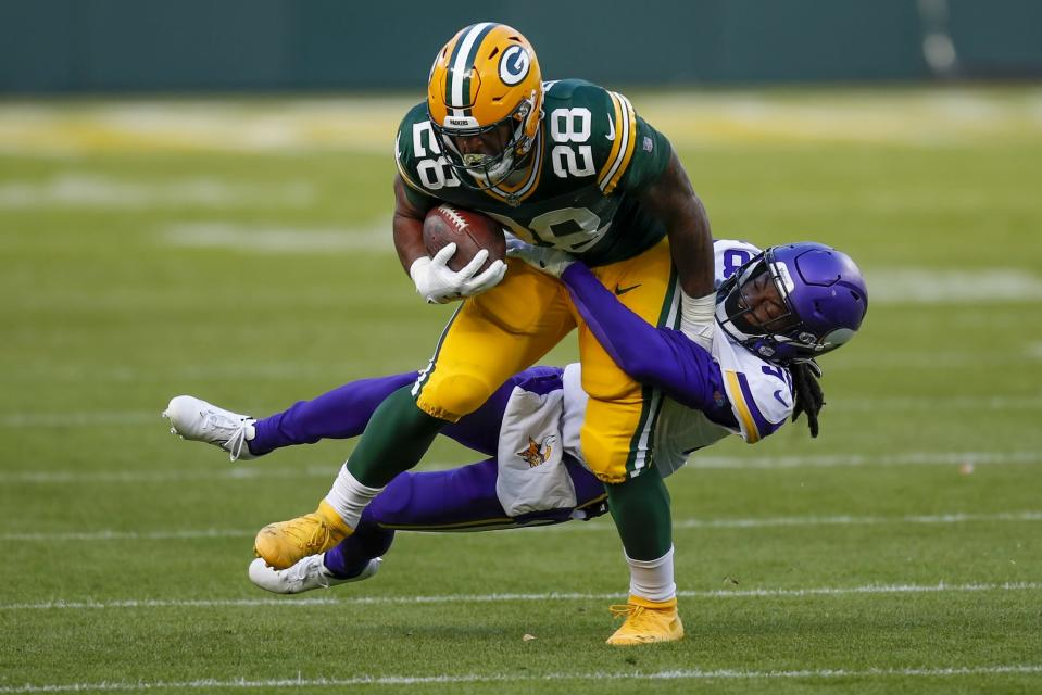 Minnesota Vikings' Harrison Hand stops Green Bay Packers' A.J. Dillon during the second half of an NFL football game Sunday, Nov. 1, 2020, in Green Bay, Wis. (AP Photo/Matt Ludtke)
