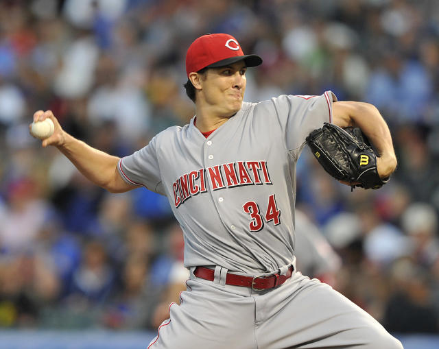 Cincinnati Reds' Homer Bailey pitches against the Chicago Cubs during the first inning of a baseball game Tuesday, Aug. 13, 2013, in Chicago. (AP Photo/Jim Prisching)