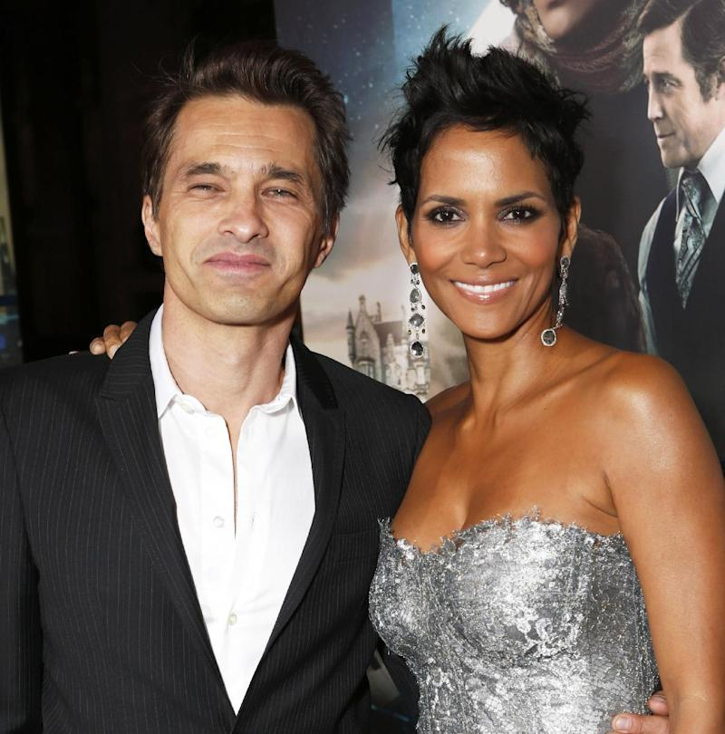 """FILE - This Oct. 24, 2012 file photo shows actors Olivier Martinez, left, and Halle Berry at the Los Angeles premiere of Berry's film,  """"Cloud Atlas,"""" in the Hollywood section of Los Angeles. A representative for the 46-year-old actress confirms that Berry and her fiance, Olivier Martinez, are expecting their first child together. Berry and Martinez announced their engagement last year. Berry has a four-year-old daughter, Nahla, with ex-boyfriend Gabriel Aubry.  (Photo by Todd Williamson/Invision/AP, file)"""