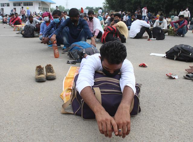 GURUGRAM, INDIA - MAY 13: Migrants waiting to be ferried from Tau Devi Lal Stadium to the railway station from where they will board a Shramik Special train to Bihar, on May 13, 2020 in Gurugram, India. (Photo by Yogendra Kumar/Hindustan Times via Getty Images)