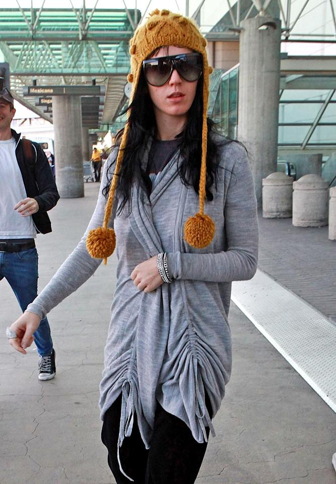 """Singer Katy Perry rocks a golden cap as she arrives at Los Angeles International Airport. Think her fiance Russell Brand is there to pick her up? <a href=""""http://www.splashnewsonline.com"""" target=""""new"""">Splash News</a> - December 24, 2009"""