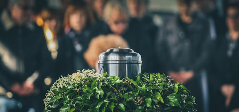 A stock image of an urn at a funeral.