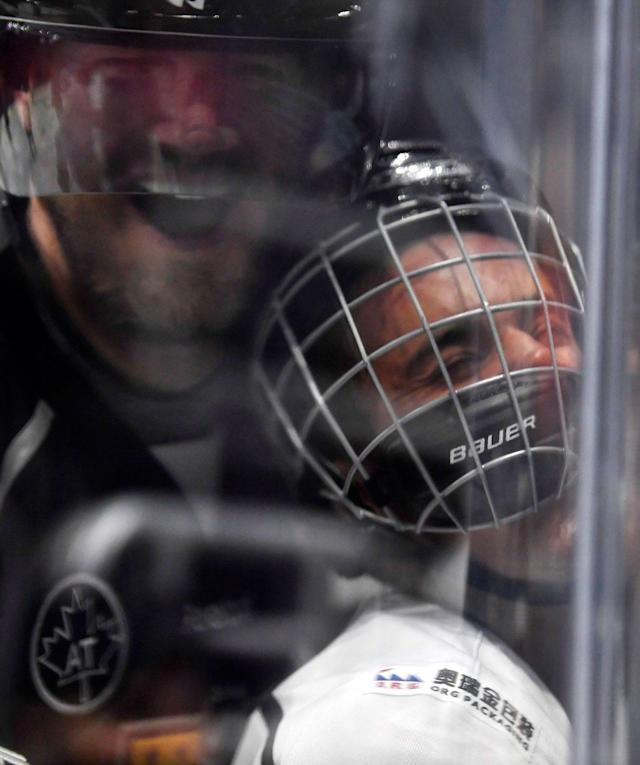 <p>Chris Pronger's hit on Justin Bieber at NHL All-Star Weekend made for an all-time great photo. (Mark J. Terrill/AP) </p>