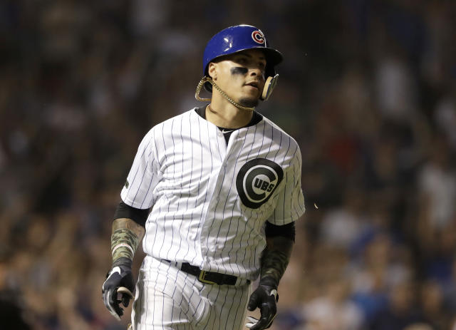 Chicago Cubs' Javier Baez rounds the bases after hitting a three-run home run during the fourth inning of a baseball game against the San Francisco Giants in Chicago, Sunday, May 27, 2018. (AP Photo/Nam Y. Huh)