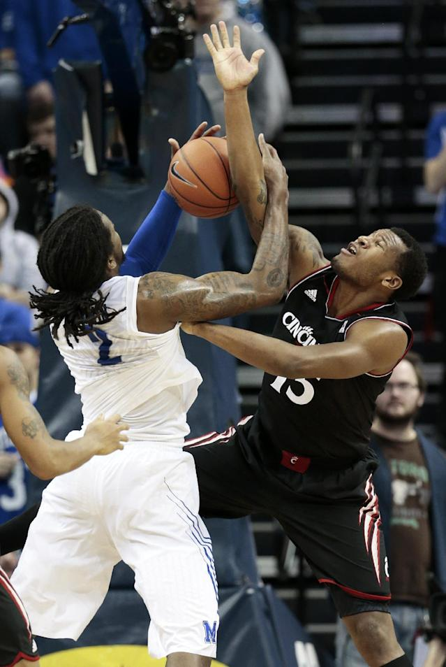 Memphis forward Shaq Goodwin (2) gets tangled with Cincinnati forward Jermaine Sanders (15) in the second half of an NCAA college basketball game Saturday, Jan. 4, 2014, in Memphis, Tenn. Cincinnati won 69-53. (AP Photo/Mark Humphrey)