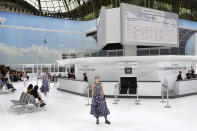 <p>Perhaps one of the most memorable runways to date is the Chanel SS16 show. The Grand Palais was unrecognisable as models checked into the world's most fashionable airport to date. <em>[Photo: Getty]</em> </p>