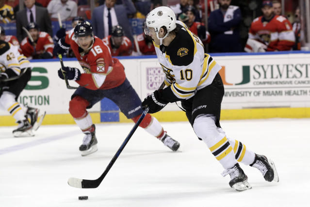 Boston Bruins left wing Anders Bjork (10) skates with the puck as Florida Panthers center Aleksander Barkov (16) pursues during the second period of an NHL hockey game, Saturday, Dec. 14, 2019, in Sunrise, Fla. (AP Photo/Lynne Sladky)