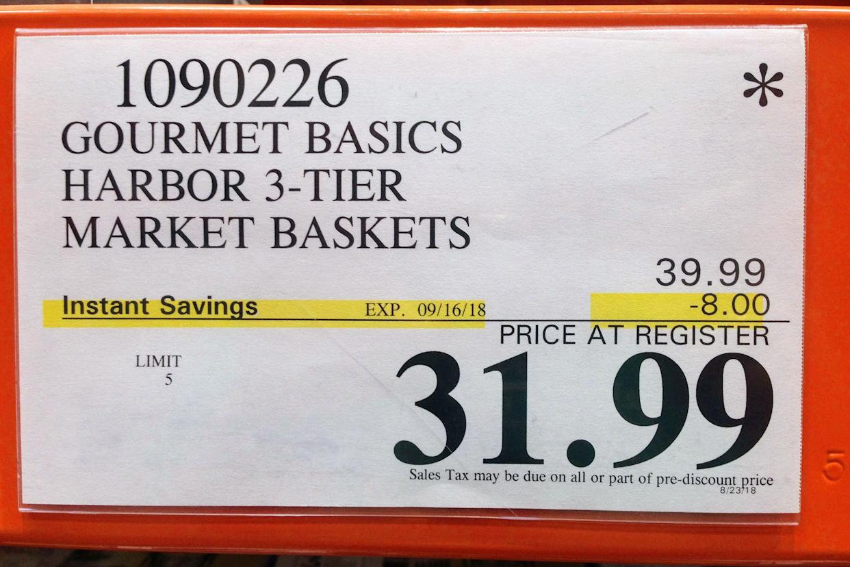 instant savings sign at Costco