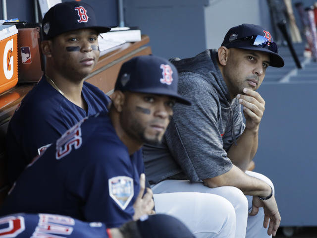 Boston Red Sox manager Alex Cora, right, watches pregame activities before Game 3 of the World Series baseball game against the Los Angeles Dodgers on Friday, Oct. 26, 2018, in Los Angeles. (AP Photo/David J. Phillip)