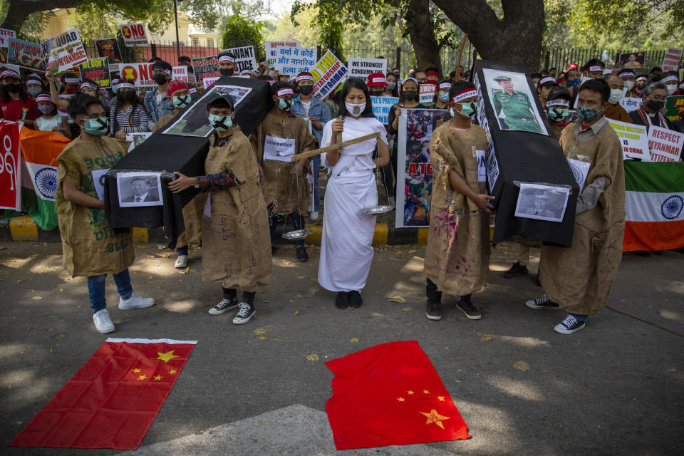 Chin refugees from Myanmar carry mock coffins of Commander in chief, Senior Gen. Min Aung Hlaing and Chinese President Xi Jinping during a protest against military coup in Myanmar, in New Delhi, India, Wednesday, March 3, 2021. (AP Photo/Altaf Qadri)