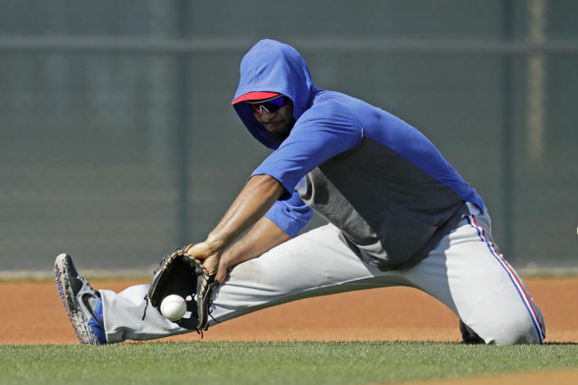Texas Rangers' Elvis Andrus fields a ball during spring training baseball practice Monday, Feb. 17, 2020, in Surprise, Ariz. (AP Photo/Charlie Riedel)