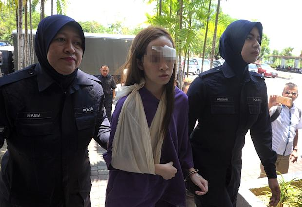 Teen driver Ng Pei Ven (centre) is charged for driving against the traffic flow on the fast lane of the North-South Expressway last Tuesday, hitting nine other cars and killing a 26-year-old motorist. ― Bernama pic
