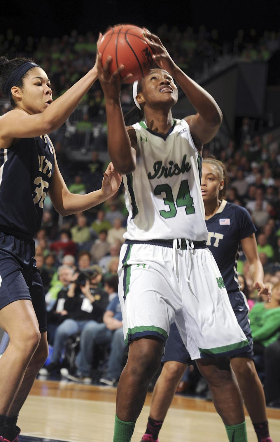 Notre Dame forward Mariska Wright (34) shoots in front of Pittsburgh forward Stasha Carey (35) during the first half of an NCAA college basketball game Thursday, Feb. 26, 2015, in South Bend, Ind. (AP Photo/Joe Raymond)