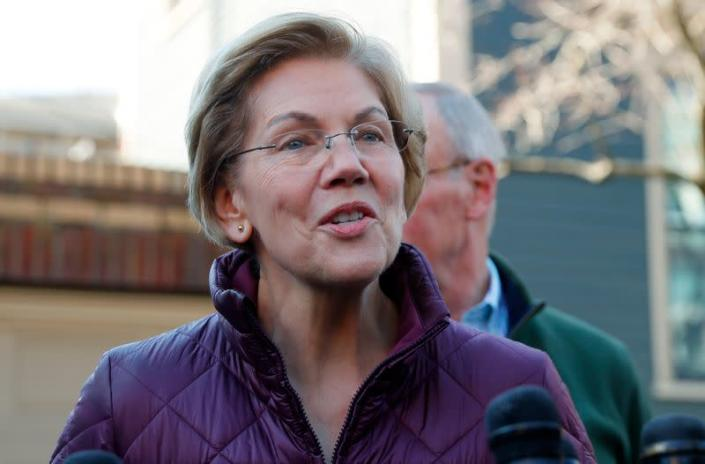 Senator Elizabeth Warren talks to reporters after telling her staff she is withdrawing from 2020 U.S. presidential race outside her home in Cambridge, Massachusetts
