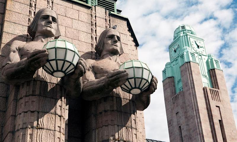 Twins and clock tower in the Helsinki Railway station. FinlandThe two distinctive features of Helsinki central Railway station: stone twins and the clock tower.