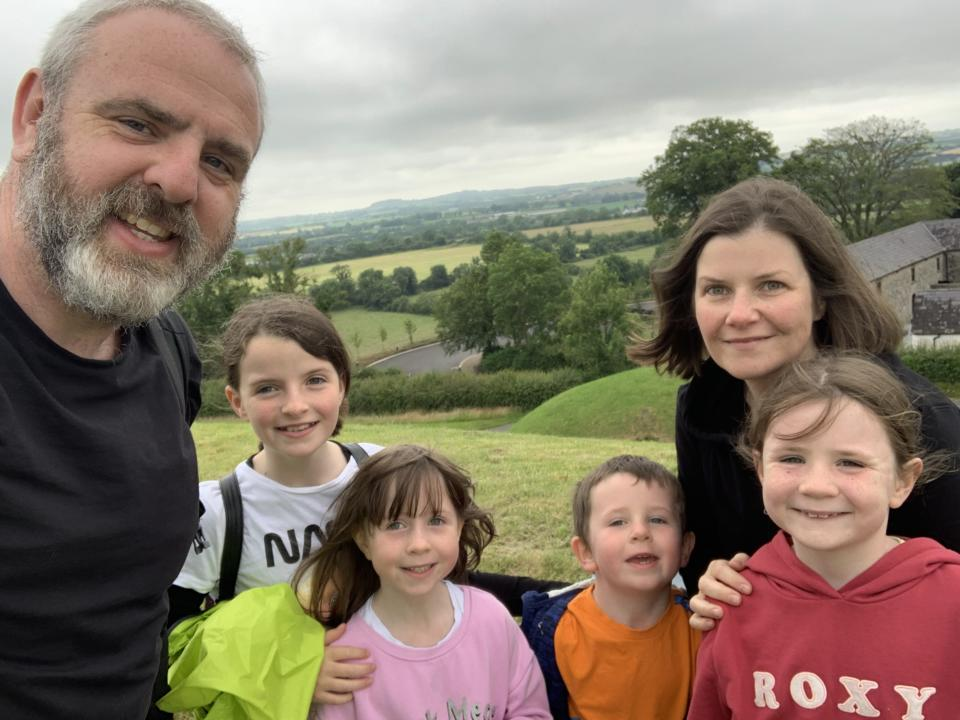 Dave Bolgar in a selfie photo in the Irish countryside with his wife and three daughters and son.
