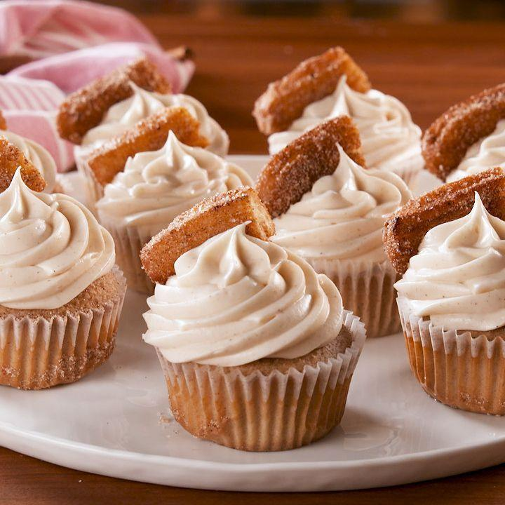 """<p>These <a href=""""https://www.delish.com/uk/cooking/recipes/a30687040/slow-cooker-cinnamon-rolls-recipe/"""" rel=""""nofollow noopener"""" target=""""_blank"""" data-ylk=""""slk:cinnamon-sugar"""" class=""""link rapid-noclick-resp"""">cinnamon-sugar</a> cupcakes use melted butter, which makes them taste more like the fried treat they are topped with. If you can't find frozen or pre-made churros, you can always make our <a href=""""https://patty-delish.hearstapps.com/uk/content/edit/e476b7c2-e414-4044-b50c-dfea1562a397"""" rel=""""nofollow noopener"""" target=""""_blank"""" data-ylk=""""slk:easy churro"""" class=""""link rapid-noclick-resp"""">easy churro</a> recipe! </p><p>Get the <a href=""""https://www.delish.com/uk/cooking/recipes/a31992796/churro-cupcakes-recipe/"""" rel=""""nofollow noopener"""" target=""""_blank"""" data-ylk=""""slk:Churro Cupcakes"""" class=""""link rapid-noclick-resp"""">Churro Cupcakes</a> recipe.</p>"""