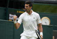 Serbia's Novak Djokovic celebrates during the men's singles match against Britain's Jack Draper on day one of the Wimbledon Tennis Championships in London, Monday June 28, 2021. (AP Photo/Kirsty Wigglesworth)