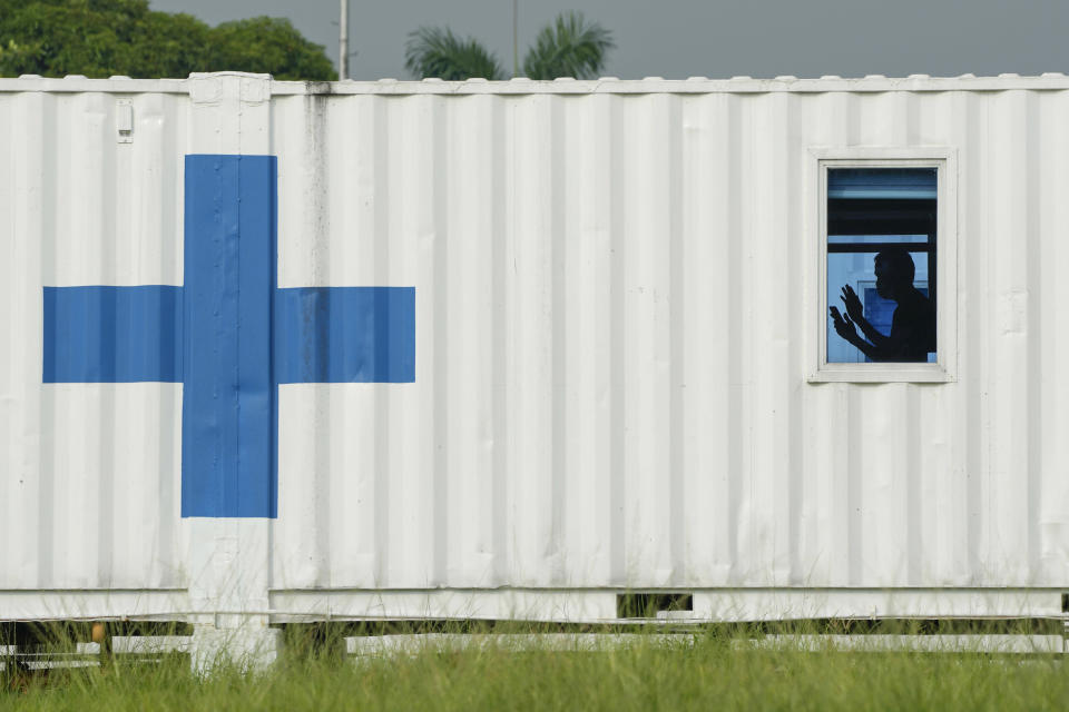 A patient uses his mobile phone inside Manila's COVID-19 Field Hospital, Philippines on Thursday, Sept. 2, 2021. The Philippines has recorded over two million COVID-19 cases as infections continue to rise in the country. (AP Photo/Aaron Favila)