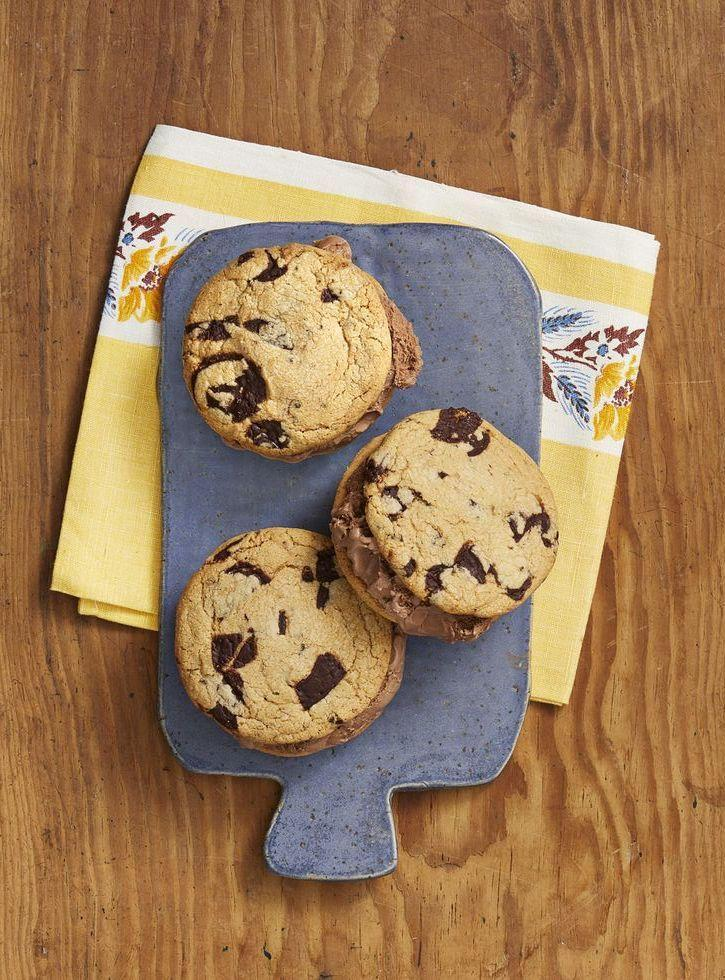 """<p>Fill these extra-chocolatey peanut butter cookies with both chocolate and vanilla ice cream to please everyone at your cookout.</p><p><strong><a href=""""https://www.thepioneerwoman.com/food-cooking/recipes/a32906141/chocolate-peanut-butter-ice-cream-sandwiches-recipe/"""" rel=""""nofollow noopener"""" target=""""_blank"""" data-ylk=""""slk:Get the recipe."""" class=""""link rapid-noclick-resp"""">Get the recipe.</a></strong></p><p><strong><a class=""""link rapid-noclick-resp"""" href=""""https://go.redirectingat.com?id=74968X1596630&url=https%3A%2F%2Fwww.walmart.com%2Fip%2FThe-Pioneer-Woman-Gorgeous-Garden-Stainless-Steel-Trigger-Ice-Cream-Scoop%2F280922665&sref=https%3A%2F%2Fwww.thepioneerwoman.com%2Ffood-cooking%2Fmeals-menus%2Fg32109085%2Ffourth-of-july-desserts%2F"""" rel=""""nofollow noopener"""" target=""""_blank"""" data-ylk=""""slk:SHOP ICE CREAM SCOOPS"""">SHOP ICE CREAM SCOOPS</a><br></strong></p>"""