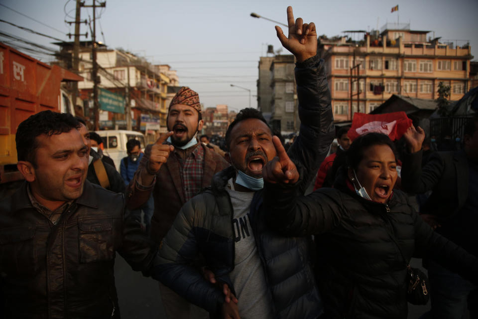 Nepalese students affiliated with Nepal Student Union shout slogans against prime minister Khadga Prasad Oli during a protest in Kathmandu, Nepal, Sunday, Dec. 20, 2020. Nepal's president dissolved Parliament on Sunday after the prime minister recommended the move amid an escalating feud within his Communist Party that is likely to push the Himalayan nation into a political crisis. Parliamentary elections will be held on April 30 and May 10, according to a statement from President Bidya Devi Bhandari's office. (AP Photo/Niranjan Shrestha)