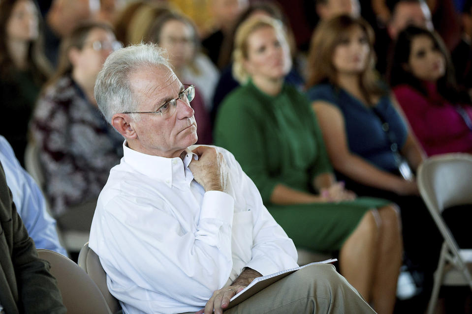 This photo taken Oct. 14, 2019, shows City of Tucson Mayor Jonathan Rothschild, center, listening to the new Tucson Fire Chief, Charles W. Ryan, III, give remarks during a badge pinning ceremony in Tucson, Ariz. Voters in Tucson will decide Tuesday, Nov. 5, whether to make the liberal enclave Arizona's only sanctuary city in an effort to confront President Donald Trump's immigration policies and the state's tough laws cracking down on people in the country illegally. (Mamta Popat/Arizona Daily Star via AP)