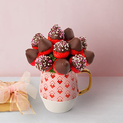 """<strong><h3>Chocolate Berry Bouquet</h3></strong><br>Chocolate-dipped strawberries are a Valentine's Day classic — but arranging them in bouquet form takes things to legendary levels.<br><br><strong>Edible Arrangements</strong> Valentine's Day Berry Bouquet, $, available at <a href=""""https://go.skimresources.com/?id=30283X879131&url=https%3A%2F%2Fwww.ediblearrangements.com%2Ffruit-gifts%2Fvalentines-day-berry-bouquet-6918"""" rel=""""nofollow noopener"""" target=""""_blank"""" data-ylk=""""slk:Edible Arrangements"""" class=""""link rapid-noclick-resp"""">Edible Arrangements</a>"""
