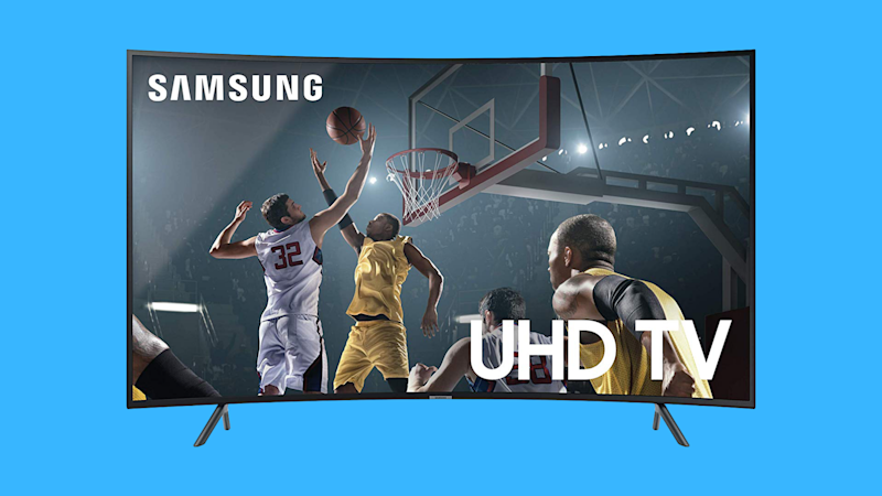 Samsung curved 55-inch 4K TV on blue background. (Photo: Amazon)