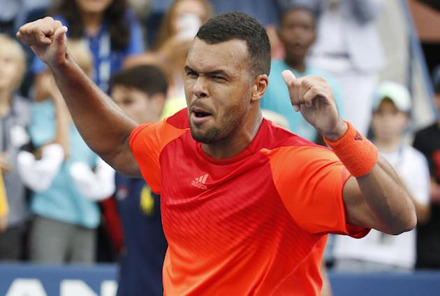 Jo-Wilifried Tsonga, of France, reacts after defeating Pablo Carreno Busta, of Spain, during the third round of the U.S. Open. (AP Photo/Kathy Willens)