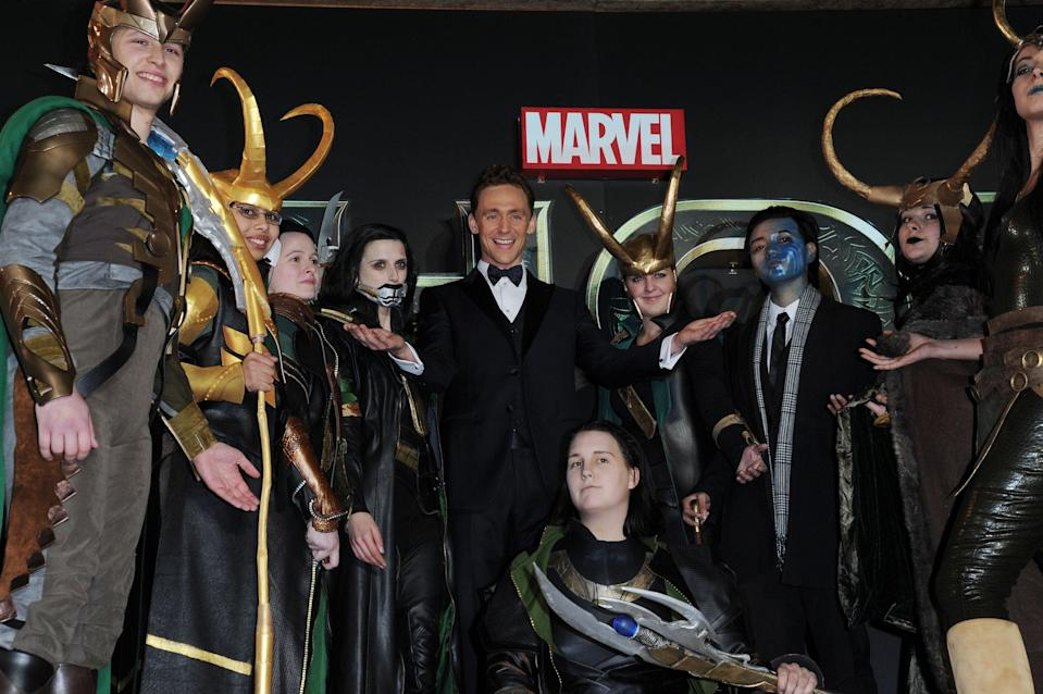 Tom Hiddleston at the premiere of 'Thor: The Dark World', surrounded by people dressed as Loki, on 22 October 2013 in London (Shutterstock)