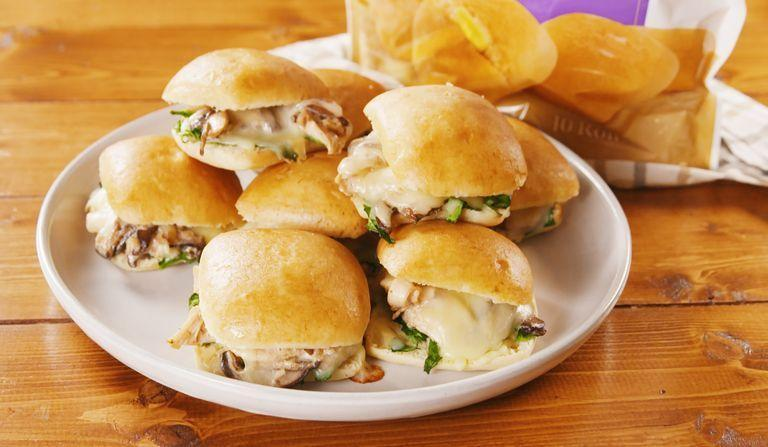"""<p>Who doesn't love a good slider? These creamy mushroom and chicken sliders are SUPER savoury, and we can't get enough of them. </p><p>Get the <a href=""""https://www.delish.com/uk/cooking/recipes/a30146443/chicken-mushroom-stuffed-rolls-recipe/"""" rel=""""nofollow noopener"""" target=""""_blank"""" data-ylk=""""slk:Chicken & Mushroom Stuffed Rolls"""" class=""""link rapid-noclick-resp"""">Chicken & Mushroom Stuffed Rolls</a> recipe.</p>"""