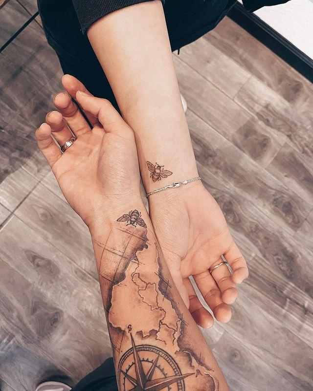 """<p>Hot tip: This bee design looks equally as pretty on an empty arm as it does on an ultra-detailed sleeve, making it a great option for couples with different <a href=""""https://www.cosmopolitan.com/style-beauty/beauty/g34103734/sagittarius-tattoo-ideas/"""" rel=""""nofollow noopener"""" target=""""_blank"""" data-ylk=""""slk:tattoo"""" class=""""link rapid-noclick-resp"""">tattoo</a> aesthetics.</p><p><a href=""""https://www.instagram.com/p/CHwbOG0B9yZ/"""" rel=""""nofollow noopener"""" target=""""_blank"""" data-ylk=""""slk:See the original post on Instagram"""" class=""""link rapid-noclick-resp"""">See the original post on Instagram</a></p>"""