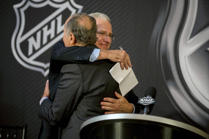 Seattle Hockey Partners president and CEO Tod Leiweke, right, is hugged by National Hockey League Commissioner Gary Bettman after the announcement by National Hockey League Board of Governors to name Seattle as the home of the league's 32nd franchise, Tuesday, Dec. 4, 2018, in Sea Island, Ga. (AP Photo/Stephen B. Morton)