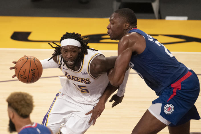 Los Angeles Lakers forward Montrezl Harrell, left, drives toward the basket as Los Angeles Clippers forward Mfiondu Kabengele defends during the second half of an NBA preseason basketball game in Los Angeles, Friday, Dec. 11, 2020. (AP Photo/Kyusung Gong)