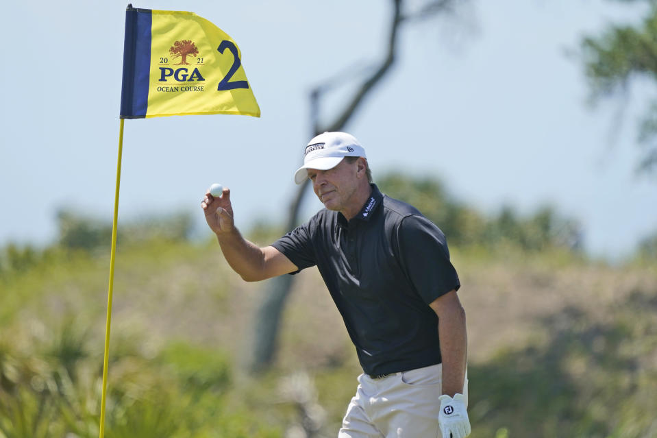 Steve Stricker tips his ball to the crowd after an eagle on the second hole during the second round of the PGA Championship golf tournament on the Ocean Course Friday, May 21, 2021, in Kiawah Island, S.C. (AP Photo/Matt York)
