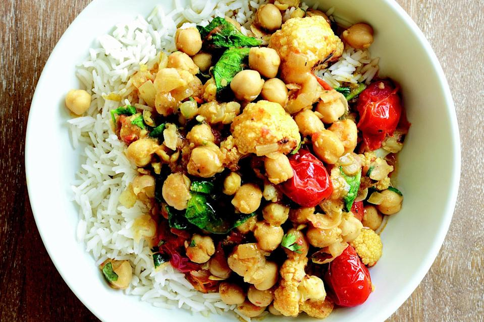 """Toasting the curry powder with other aromatic ingredients before adding the liquid intensifies the flavor of this quick take on chana masala. You can roast the cauliflower and tomatoes a couple days ahead; cool, cover, and refrigerate until ready to use. <a href=""""https://www.epicurious.com/recipes/food/views/chickpea-curry-with-roasted-cauliflower-and-tomatoes-51190620?mbid=synd_yahoo_rss"""" rel=""""nofollow noopener"""" target=""""_blank"""" data-ylk=""""slk:See recipe."""" class=""""link rapid-noclick-resp"""">See recipe.</a>"""