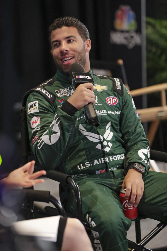 Bubba Wallace takes part in an interview during NASCAR Daytona 500 auto racing media day at Daytona International Speedway, Wednesday, Feb. 12, 2020, in Daytona Beach, Fla. (AP Photo/John Raoux)