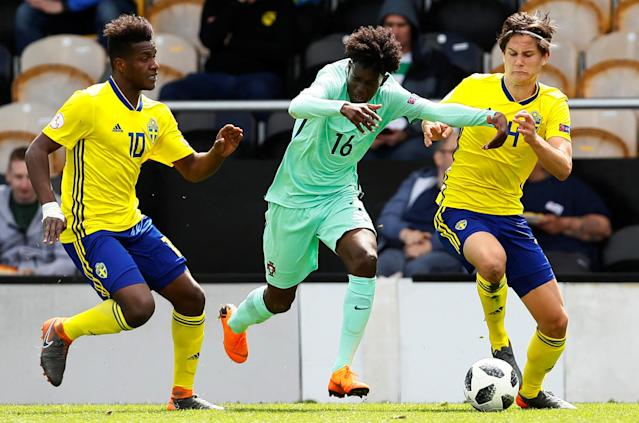 Soccer Football - UEFA European Under-17 Championship - Group B - Norway v Slovenia - Pirelli Stadium, Loughborough, Britain - May 10, 2018 Sweden's Manasse Kusu and Helmer Andersson in action with Portugal's Umaro Embalo Action Images via Reuters/Jason Cairnduff