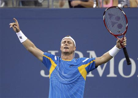 Lleyton Hewitt of Australia celebrates defeating Juan Martin Del Potro of Argentina in the 5th set at the U.S. Open tennis championships in New York, August 30, 2013. REUTERS/Shannon Stapleton