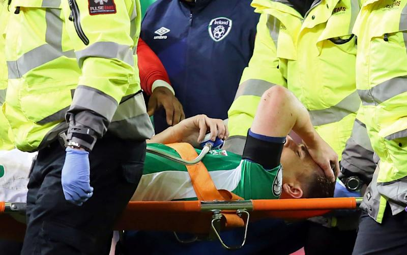 Seamus Coleman has had an operation to insert metal screws to help the broken bones fuse together again - AFP
