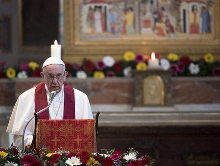 Pope Francis leads a mass at the Basilica of Saint Bartholomew on Tiber island in Rome
