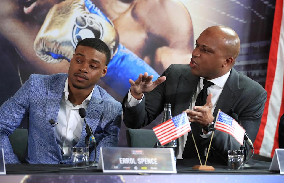 Errol Spence (L) with trainer Derrick James during the press conference at Bramall Lane, Sheffield. (Tim Goode/PA Wire)