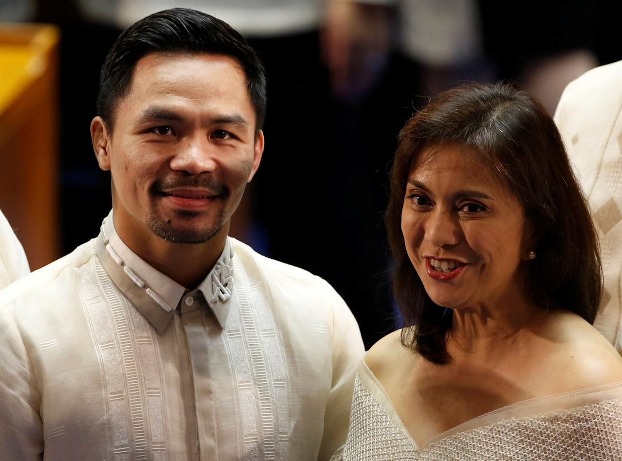 Vice-President Leni Robredo (R) and Filipino boxer and Senator Manny Pacquiao arrive before Philippine President Rodrigo Duterte speaks during his first State of the Nation Address at the Philippine Congress in Quezon city, Metro Manila, Philippines July 25, 2016. REUTERS/Erik De Castro