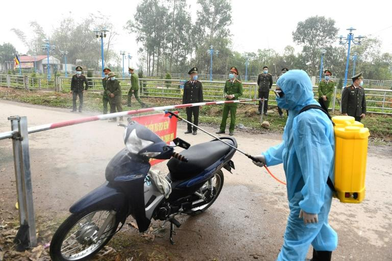 The locking down of the Vietnamese commune of Son Loi, about 40 kilometres (25 miles) from Hanoi, is the first mass quarantine outside of China since the virus emerged