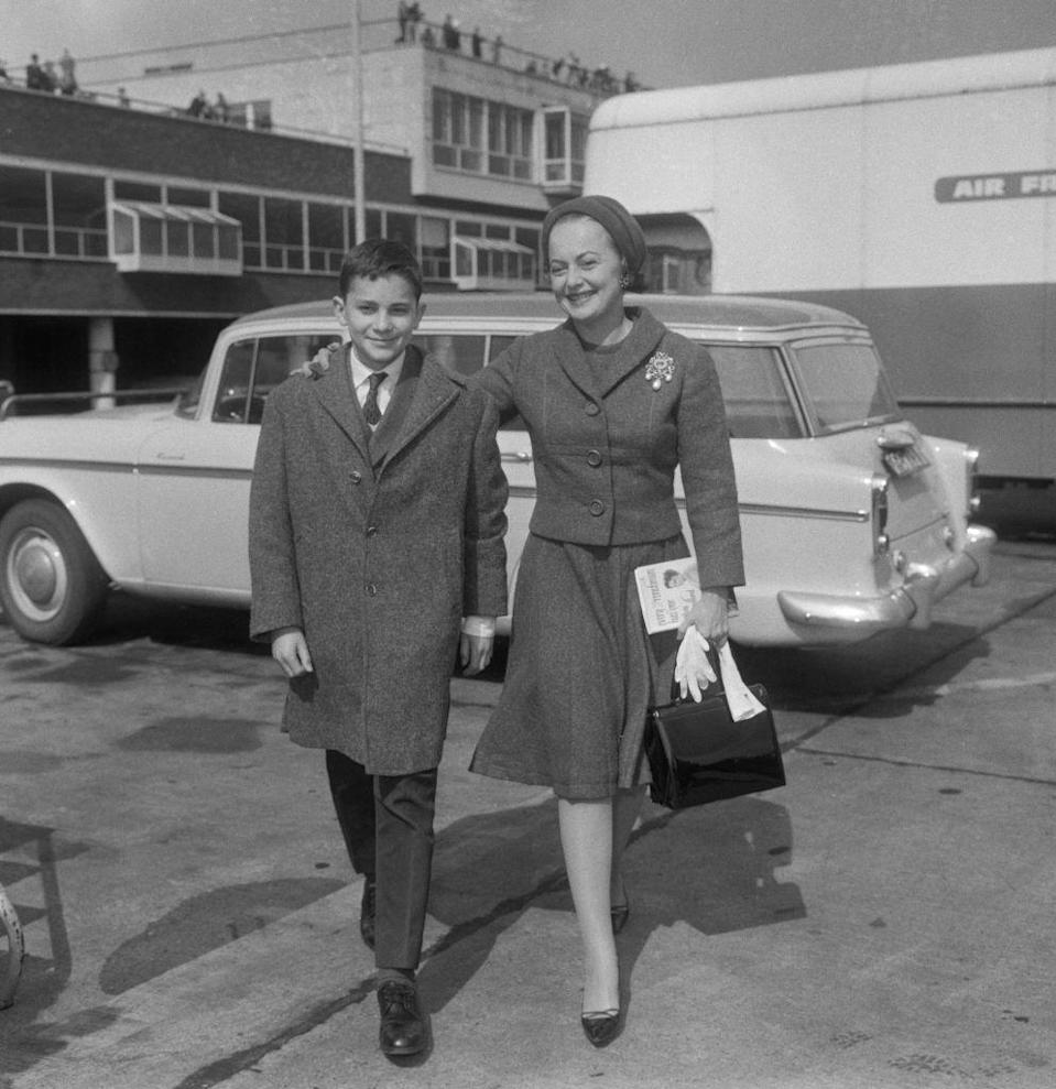 <p>Olivia walked around London with her son, Benjamin, in 1963. </p>