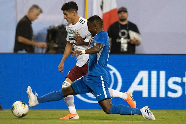 Mexico's Uriel Antuna (L) vies for the ball with Martinique's Samuel Camille (R) during their CONCACAF Gold Cup Group A match in Charlotte, North Carolina (AFP Photo/Jim WATSON)