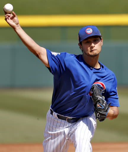 Chicago Cubs pitcher Yu Darvish warms up during the first inning of a spring training baseball game against the Los Angeles Dodgers, Tuesday, March 6, 2018, in Mesa, Ariz. (AP Photo/Matt York)