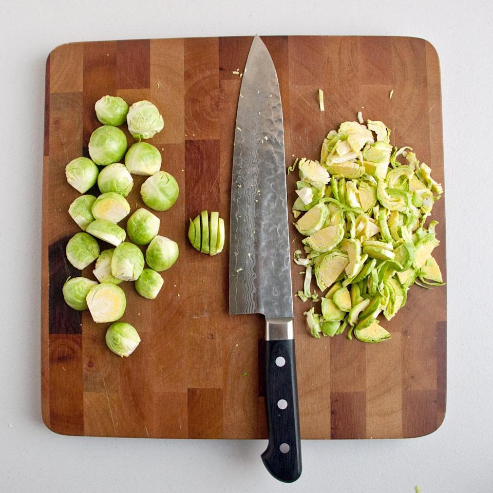 <p>Turn the sprouts cut-side down, and shred them by thinly slicing them cross-wise from root to top.</p>