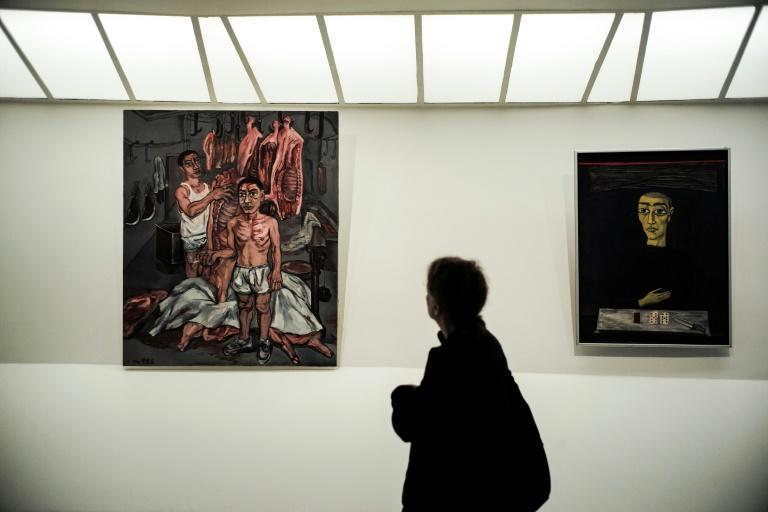 "A woman looks at Zeng Fanzhi's ""Meat"" (1992)"