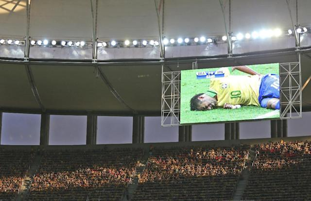 FILE - In this June 15, 2013 file photo, Brazil's Neymar is seen on a giant screen as he was injured during the opening match between Brazil and Japan in group A of the soccer Confederations Cup at the National Stadium in Brasilia, Brazil. (AP Photo/Andre Penner, File)